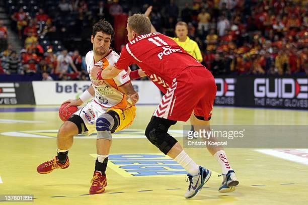 Adam Wisniewski of Poland defends against Filip Mirkulovski of Macedonia during the Men's European Handball Championship second round group one match...