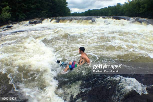 Adam Wolf of South Portland swims in the rapids at Steep Falls with his one yearold Australian Shepherd and Border Collie mix Harper on Tuesday July...