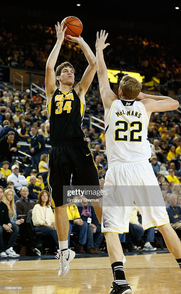 Adam Woodbury #34 of the Iowa Hawkeyes gets off a second half shot over Blake McLimans #22 of the Michigan Wolverines at Crisler Center on January 6, 2013 in Ann Arbor, Michigan. Michigan won the game 95-67.