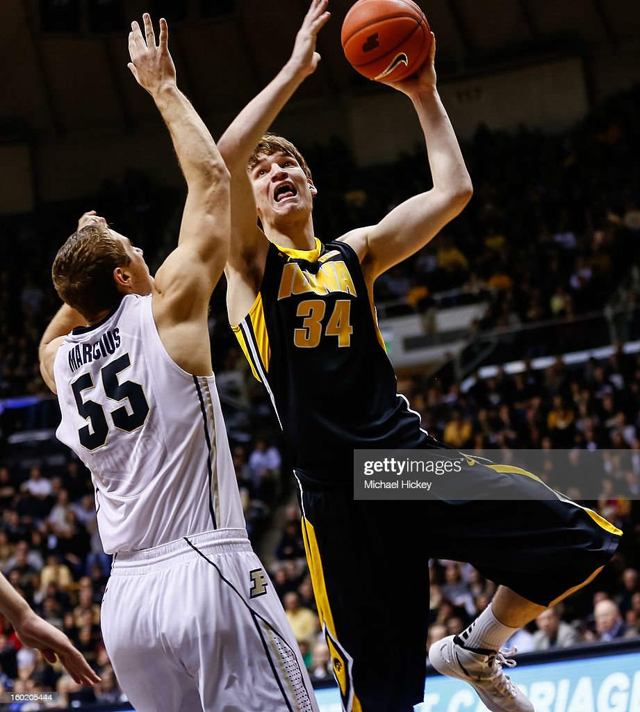 Adam Woodbury #34 of the Iowa Hawkeyes shoots over Sandi Marcius #55 of the Purdue Boilermakers at Mackey Arena on January 27, 2013 in West Lafayette, Indiana. Purdue defeated Iowa 65-62 in overtime.