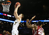 Adam Woodbury of the Iowa Hawkeyes shoots the game winning basket in overtime to defeat the Temple Owls during the first round of the 2016 NCAA Men's...