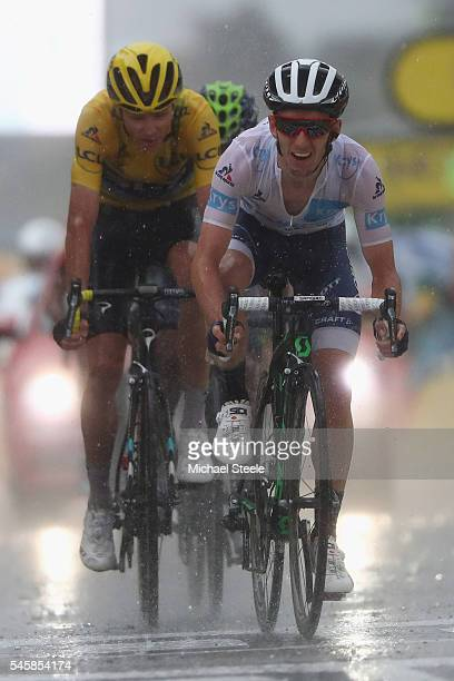 Adam Yates of Great Britain and Orica Bike Exchange finishes ahead of Chris Froome of Great Britain and Team Sky during the 1845 km stage 9 of Le...