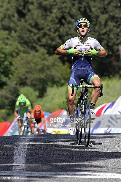Adam Yates of Great Britain and Orica Greenedge celebrates after he crosses the finish line to win the 6th stage of the 50th Presidential Cycling...