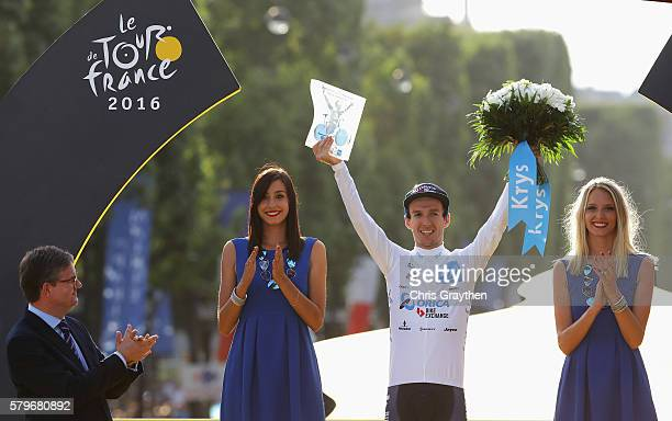 Adam Yates of Great Britain and Orica Greenedge celebrates as he is crowned the best young rider following stage twenty one of the 2016 Le Tour de...