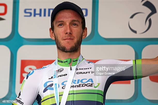 Adam Yates of Great Britain and Orica Greenedge celebrates on the podium after he wins the 6th stage of the 50th Presidential Cycling Tour a 182 km...