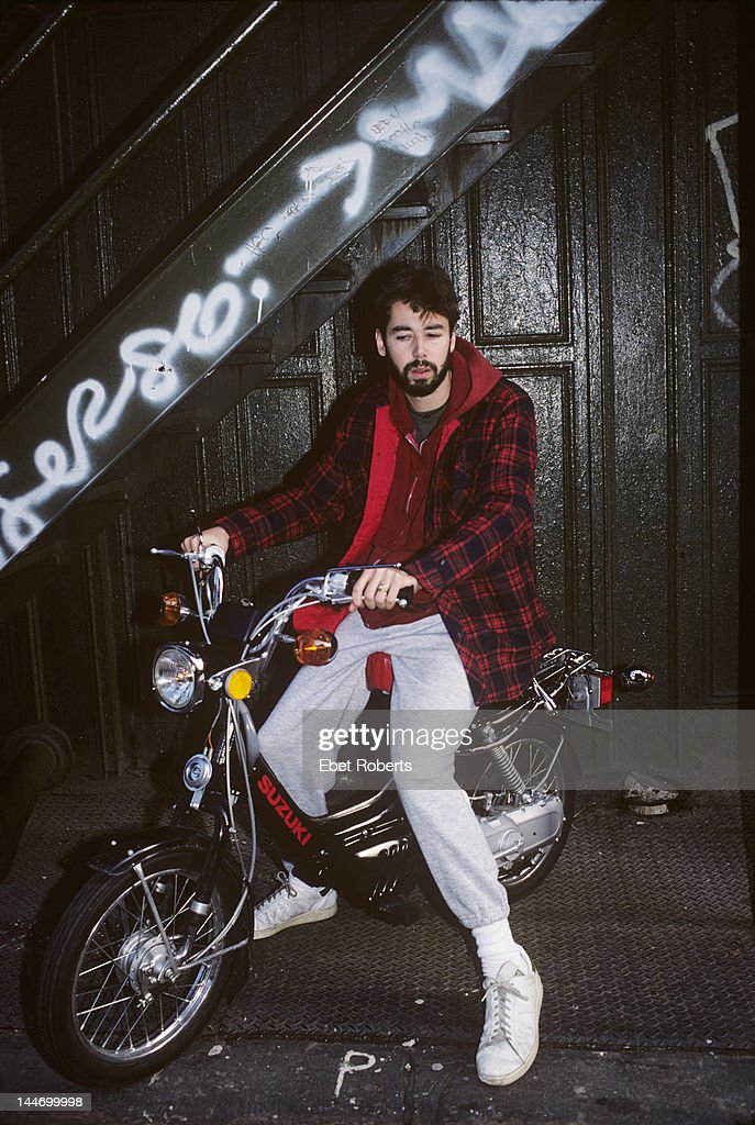 Adam Yauch of the Beastie Boys poses on a Suzuki moped in New York City on November 30th 1988 Yauch was also known by the stage name MCA