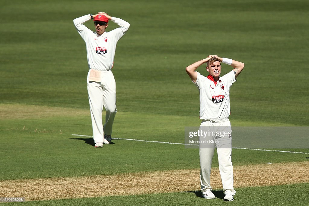 <a gi-track='captionPersonalityLinkClicked' href=/galleries/search?phrase=Adam+Zampa+-+Cricket+Player&family=editorial&specificpeople=15110382 ng-click='$event.stopPropagation()'>Adam Zampa</a> (R) and Jake Lehmann of the Redbacks react during day one of the Sheffield Shield match between South Australia and Victoria at Adelaide Oval on February 14, 2016 in Adelaide, Australia.