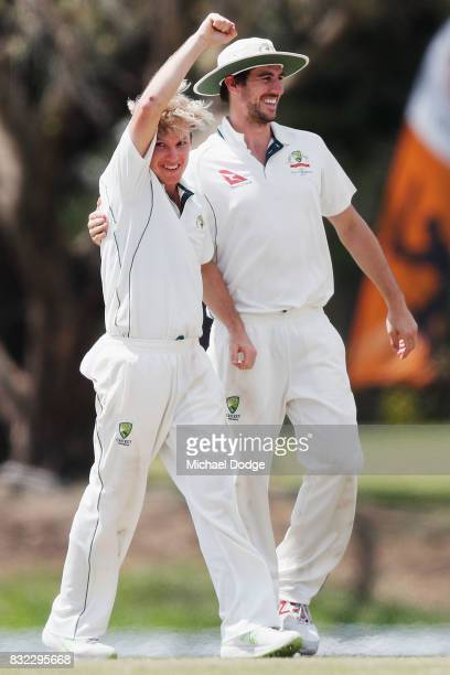 Adam Zampa celebrates a wicket with Pat Cummins during day three of the Australian Test cricket intersquad match at Marrara Cricket Ground on August...