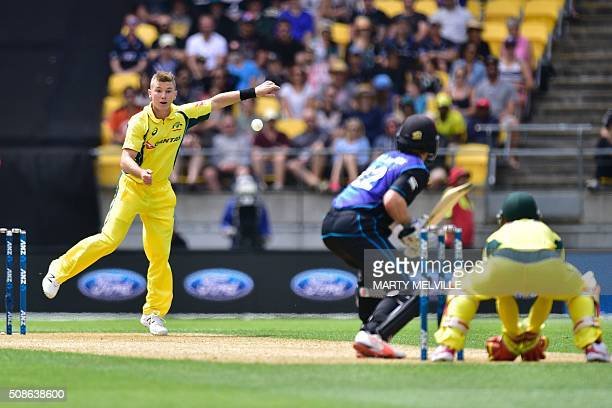 Adam Zampa of Australia bowls to Kane Williamson of New Zealand watched by Matthew Wade keeper for Australia during the 2nd oneday international...