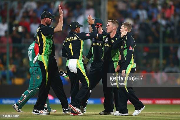 Adam Zampa of Australia celebrates after taking the wicket of Shuvagata Hom of Bangladesh during the ICC World Twenty20 India 2016 Super 10s Group 2...