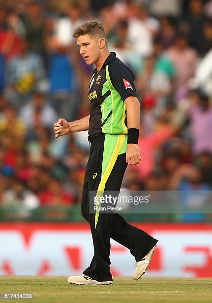 Adam Zampa of Australia celebrates after taking the wicket of Umar Akmal of Pakistan during the ICC WT20 India Group 2 match between Pakistan and...
