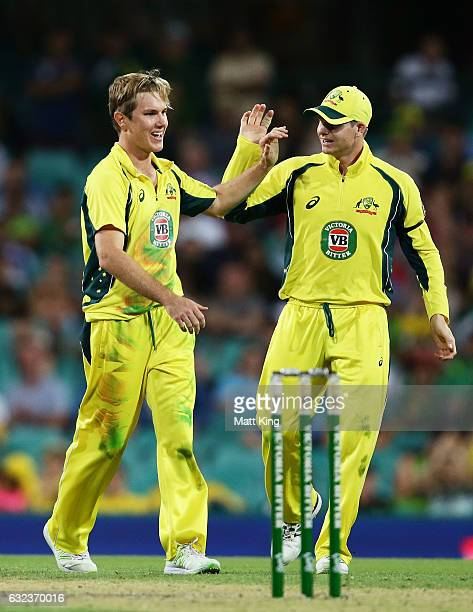 Adam Zampa of Australia celebrates with Steve Smith after taking the wicket of Mohammad Rizwan of Pakistan during game four of the One Day...