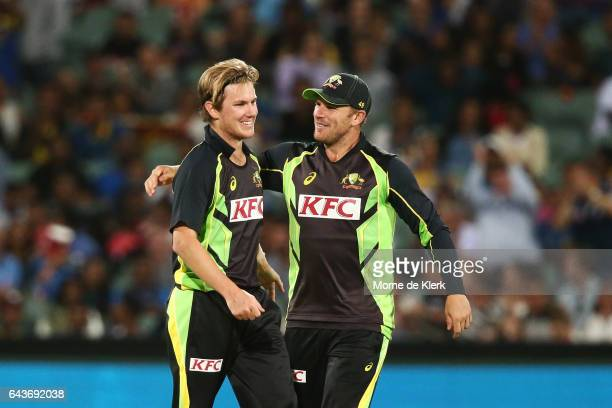 Adam Zampa of Australia is congratulated by teammate Aaron Finch after Zampa got the wicket of Dasun Shanaka of Sri Lanka during the International...