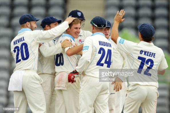 Adam Zampa of the Blues celebrates with team mates after taking the wicket of Chris Hartley of the Bulls during day one of the Sheffield Shield match...