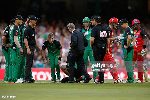 Adam Zampa of the Melbourne Stars is assisted after being struck in the face by the ball in a run out during the Big Bash League match between the...