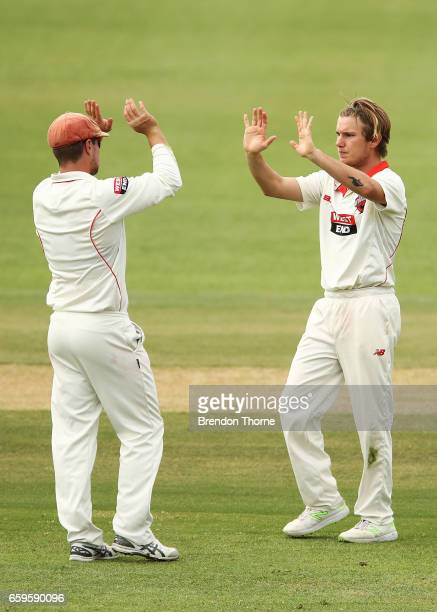 Adam Zampa of the Redbacks celebrates with team mates after claiming the wicket ofTravis Dean of the Bushrangers during the Sheffield Shield final...