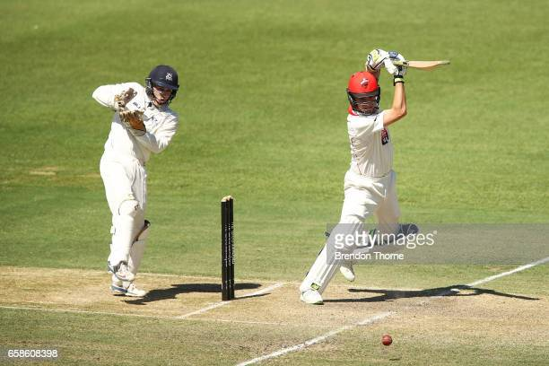 Adam Zampa of the Redbacks plays a cover drive during the Sheffield Shield final between Victoria and South Australia on March 28 2017 in Alice...