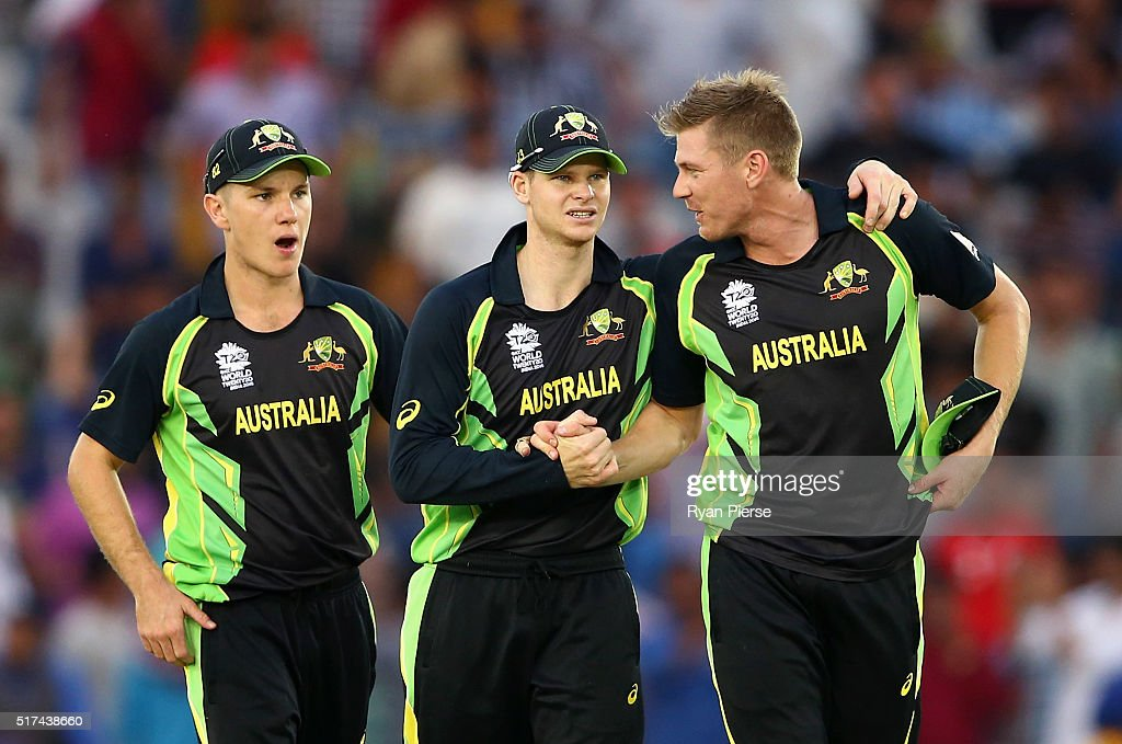 Adam Zampa, Steve Smith and James Faulkner of Australia celebrate victory during the ICC WT20 India Group 2 match between Pakistan and Australia at I.S. Bindra Stadium on March 25, 2016 in Mohali, India.