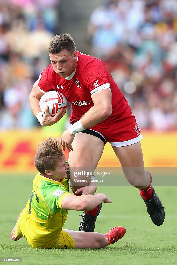 Adam Zaruba of Canada is tackled during the 2016 Sydney Sevens match between Australia and Canada at Allianz Stadium on February 6, 2016 in Sydney, Australia.