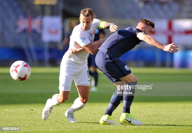 Adam Zrelak Calum Chambers during the UEFA European Under21 match between Slovakia and England at Kolporter Arena on June 19 2017 in Kielce Poland