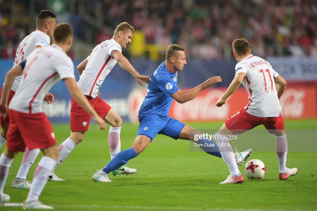 Adam Zrelak of Slovakia is closed down by Poland defenders during the UEFA European Under-21 Championship match between Poland and Slovakia at Lublin Stadium on June 16, 2017 in Lublin, Poland.