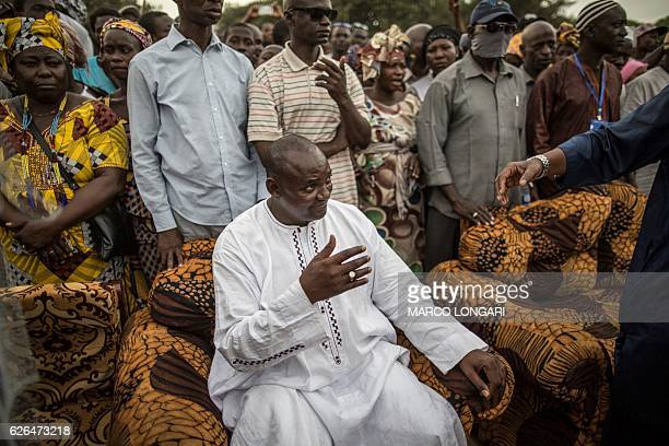 Adama Barrow the flagbearer of the coalition of the seven opposition political parties in Gambia gestures while greeting supporters during a...