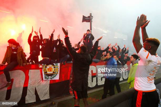 Adama Diakhaby and Joris Gnagnon of Rennes celebrate with fans at the end of the match during the French Ligue 1 match between Rennes and Lorient at...