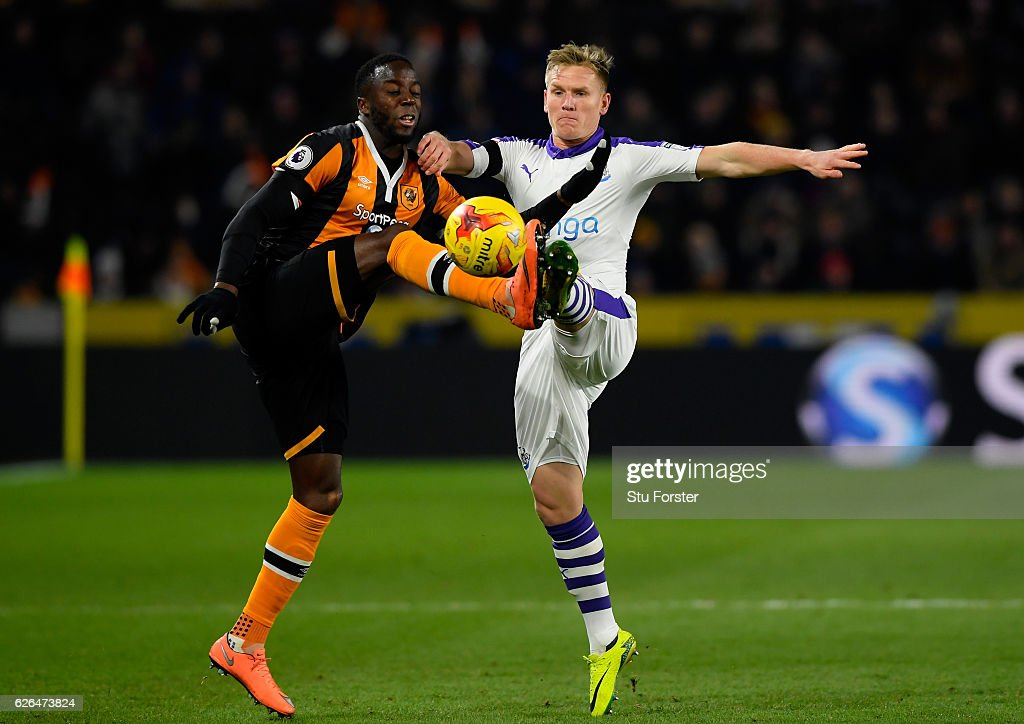 Adama Diomande of Hull City and Matt Ritchie of Newcastle United battle for the ball during the EFL Cup Quarter-Final match between Hull City and Newcastle United at KCOM Stadium on November 29, 2016 in Hull, England.