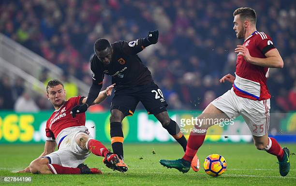 Adama Diomande of Hull City battles with Ben Gibson and Calum Chambers of Middlesbrough during the Premier League match between Middlesbrough and...
