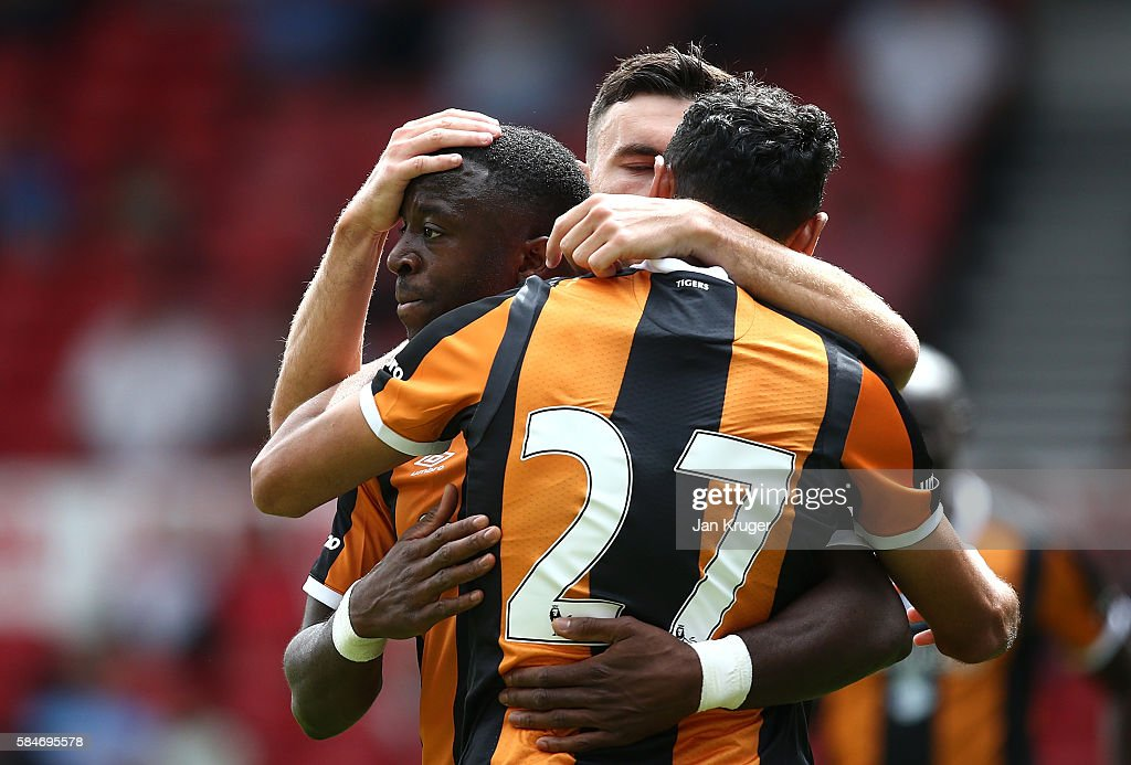 Adama Diomande of Hull City celebrates his second goal with team mates during the pre-season friendly match between Nottingham Forest and Hull City at City Ground on July 30, 2016 in Nottingham, England.