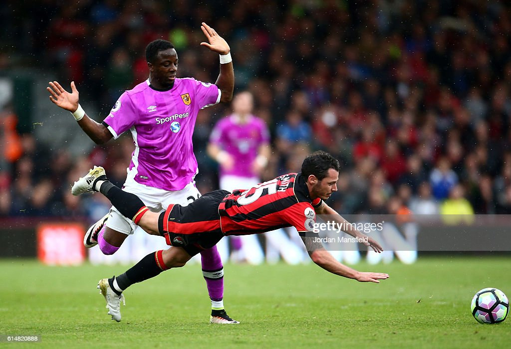 Adama Diomande of Hull City (L) fouls Adam Smith of AFC Bournemouth (R) during the Premier League match between AFC Bournemouth and Hull City at Vitality Stadium on October 15, 2016 in Bournemouth, England.