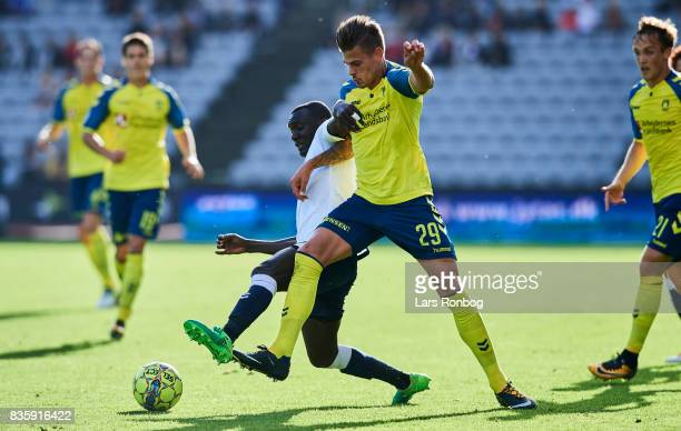 Adama Guira of AGF Aarhus and Jan Kliment of Brondby IF compete for the ball during the Danish Alka Superliga match between AGF Aarhus and Brondby IF...