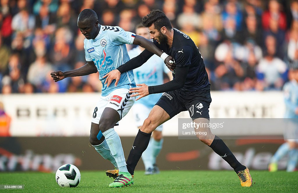 Adama Guira of Sonderjyske and Mikael Ishak of Randers FC compete for the ball during the Danish Alka Superliga match between Sonderjyske and Randers FC at Sydbank Park on May 26, 2016 in Haderslev, Denmark.