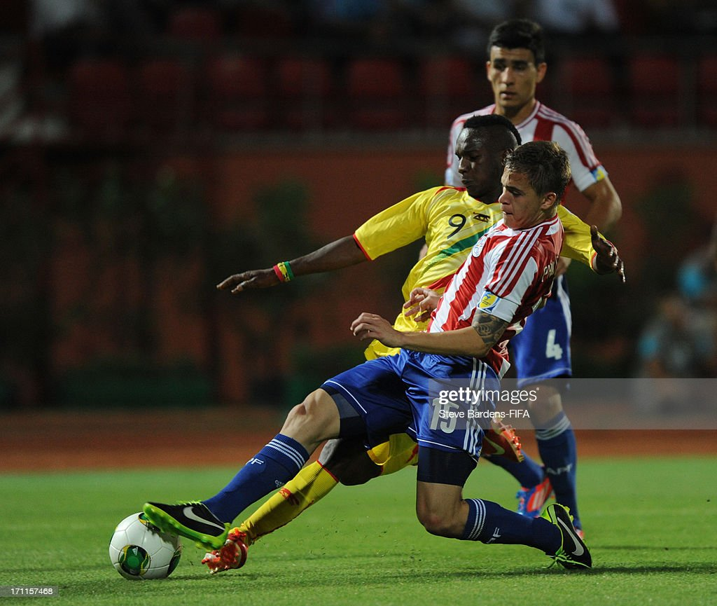 Adama Niane of Mali is tackled by Robert Piris da Motta of Paraguay during the FIFA U20 World Cup Group D match between Paraguay and Mali at Kamil Ocak Stadium on June 22, 2013 in Gaziantep, Turkey.