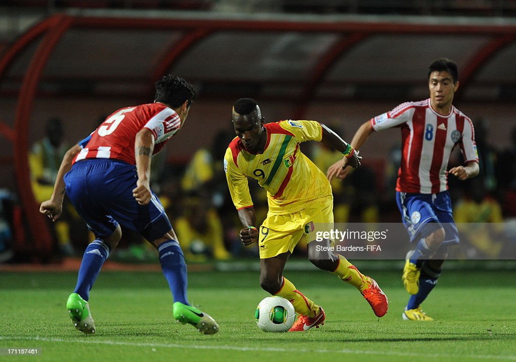 Adama Niane of Mali takes on the Paraguay defence during the FIFA U20 World Cup Group D match between Paraguay and Mali at Kamil Ocak Stadium on June 22, 2013 in Gaziantep, Turkey.