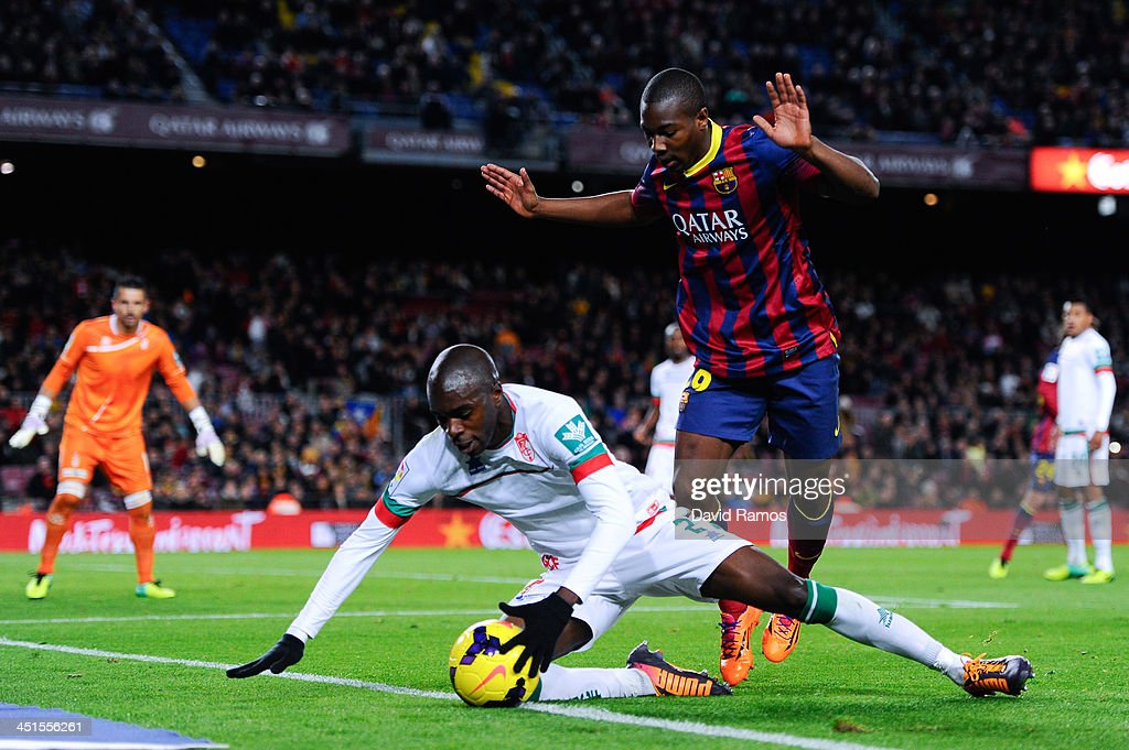 Adama of FC Barcelona duels for the ball with Foulquier of Granada CF during the La Liga match between FC Barcelona and Granda CF at Camp Nou on November 23, 2013 in Barcelona, Spain.