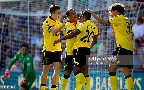 Adama Traore of Aston Villa celebrates the Aston Villa goal with team mates during the Barclays Premier League match between Crystal Palace and Aston...