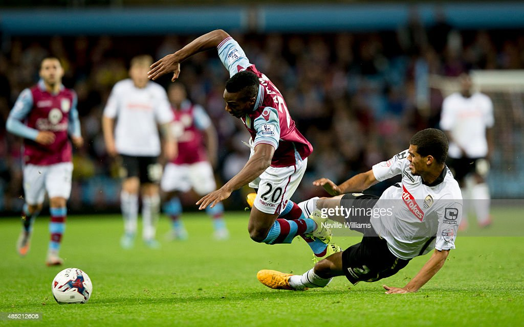Adama Traore of Aston Villa is challenged by Mawouna Amevor of Notts County during the Capital One Cup Second Round match between Aston Villa and Notts County at Villa Park on August 25, 2015 in Birmingham, England.