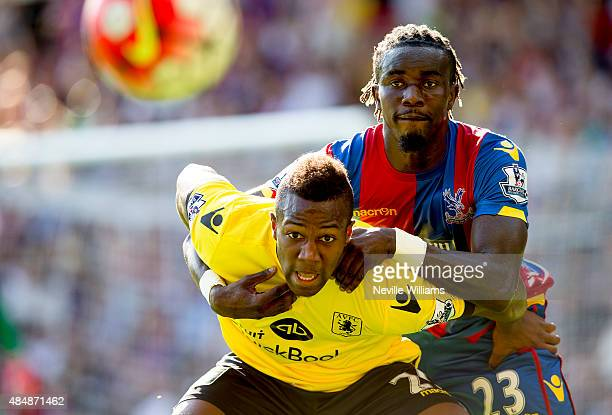 Adama Traore of Aston Villa is challenged by Pape Souare of Crystal Palace during the Barclays Premier League match between Crystal Palace and Aston...