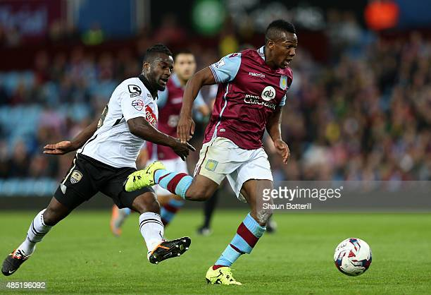 Adama Traore of Aston Villa is challenged by Stanley Aborah of Notts County during the Capital One Cup second round match between Aston Villa and...