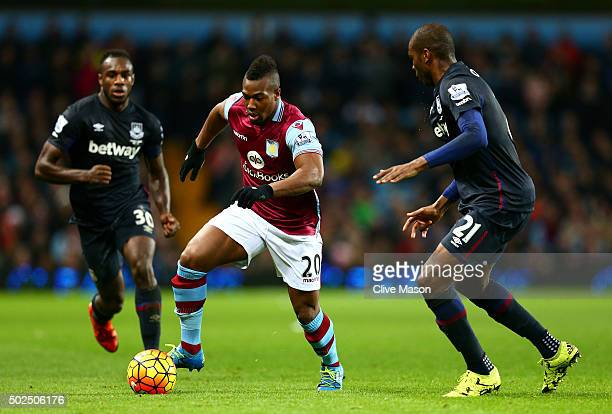 Adama Traore of Aston Villa makes a break past Angelo Ogbonna Obinza of West Ham United during the Barclays Premier League match between Aston Villa...