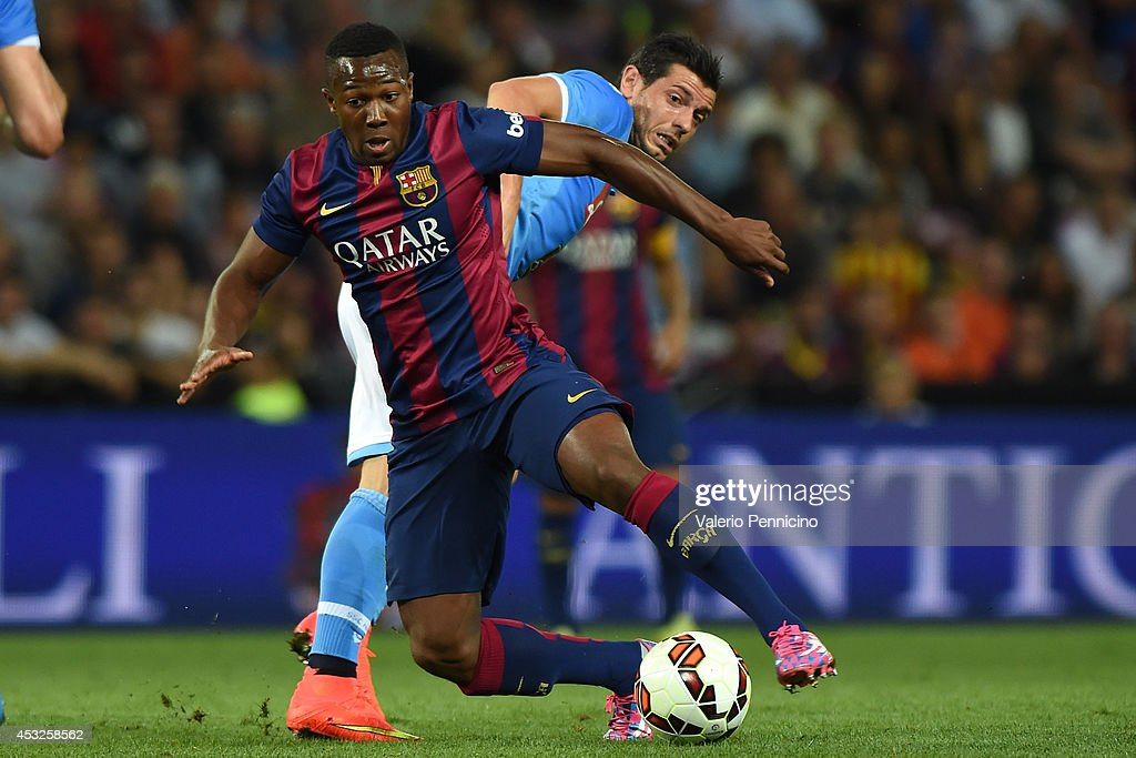 Adama Traore (L) of FC Barcelona is challenged by Blerim Dzemaili of SSC Napoli during the pre-season friendly match between FC Barcelona and SSC Napoli on August 6, 2014 in Geneva, Switzerland.