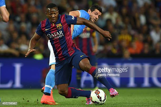 Adama Traore of FC Barcelona is challenged by Blerim Dzemaili of SSC Napoli during the preseason friendly match between FC Barcelona and SSC Napoli...