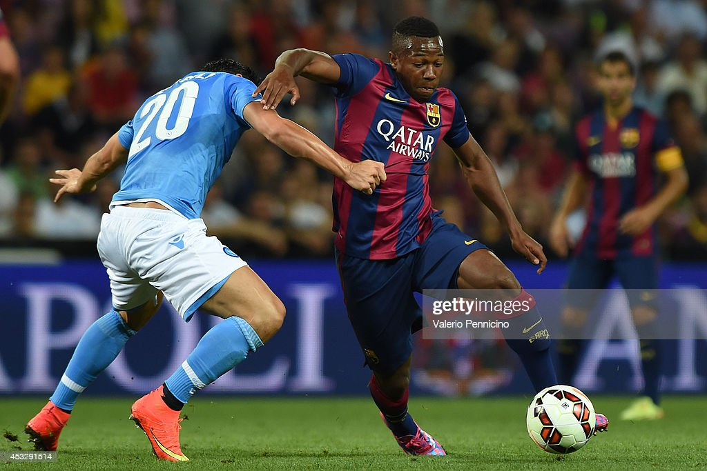 Adama Traore (R) of FC Barcelona is challenged by Blerim Dzemaili of SSC Napoli during the pre-season friendly match between FC Barcelona and SSC Napoli on August 6, 2014 in Geneva, Switzerland.