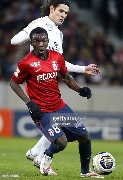 Adama Traore of Lille and Edinson Cavani of PSG in action during the French League Cup match between Lille OSC and Paris SaintGermain at Grand Stade...