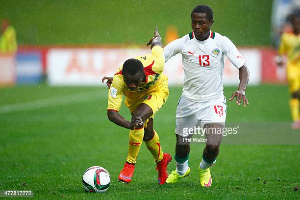 Adama Traore of Mali holds back Alhassane Sylla of Senegal during the FIFA U20 World Cup Third Place Playoff match between Senegal and Mali at North...