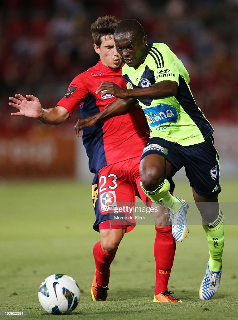 Adama Traore of Melbourne is tackled by Evan Kostopoulos of Adelaide during the round 20 A-League match between Adelaide United and the Melbourne Victory at Hindmarsh Stadium on February 8, 2013 in Adelaide, Australia.