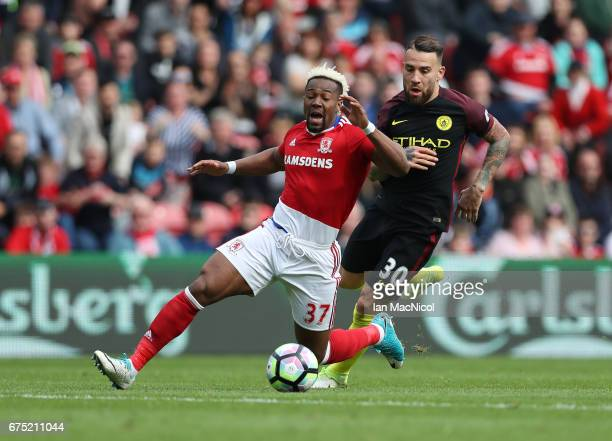 Adama Traore of Middlesborough vies with Nicolas Otamendi of Manchester City during the Premier League match between Middlesbourgh and Manchester...