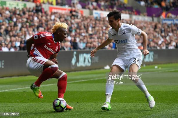 Adama Traore of Middlesbrough attempts to get away from Jack Cork of Swansea City during the Premier League match between Swansea City and...