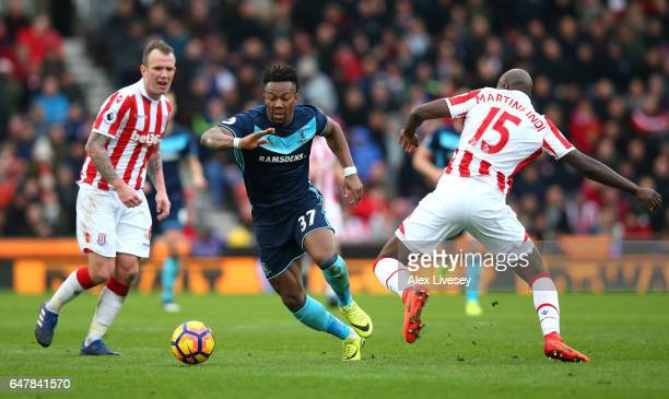 Adama Traore of Middlesbrough is fouled by Bruno Martins Indi of Stoke City during the Premier League match between Stoke City and Middlesbrough at...